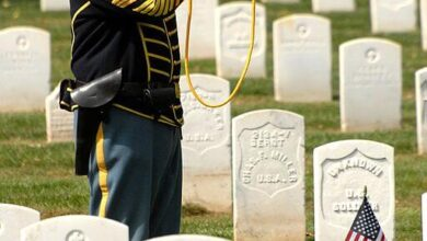 Retired Col. Sam Young plays Taps at Leavenworth Cemetery for Fort Larned soldiers who died 1859-1878
